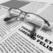 Eye glasses and newspaper - Stock Photo