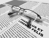 Eye glasses and newspaper — Stock Photo