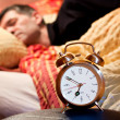 Room clock man lazy sleep wake alert — Stock Photo
