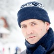 Cold winter snow outdoor portrait of man — Stock Photo