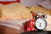 Room clock bed lazy sleep wake alert — Stock Photo