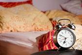Room clock bed lazy sleep wake alert — Stock Photo