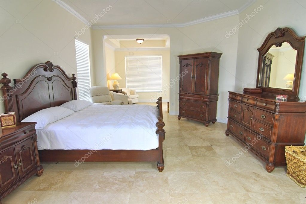 Overview of a beautiful classic bedroom suite in a private residence with a travertine floor — Stock Photo #7335158