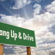 Hang Up and Drive Green Road Sign - Stock Photo