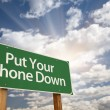 Royalty-Free Stock Photo: Put Your Phone Down Green Road Sign
