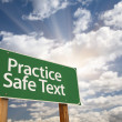 Royalty-Free Stock Photo: Practice Safe Text Green Road Sign