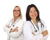 Two Female Doctors or Nurses on White — Stock Photo