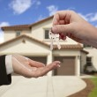 Handing Over the House Keys in Front of New Home — Stock Photo #6917500