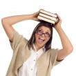 Ethnic Student with Books on Her Head Over White — Stock Photo #6946838