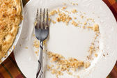 Overhead of Pie, Fork and Copy Spaced Crumbs on Plate — Stock Photo