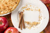 Pie, Apples, Cinnamon Sticks and Copy Spaced Crumbs on Plate — Stock Photo