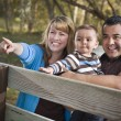 Happy Mixed Race Family Playing In The Park — Stock Photo #7678265