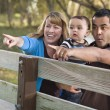 Happy Mixed Race Family Playing In The Park — Stock Photo #7678270