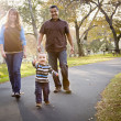 Happy Mixed Race Ethnic Family Walking In The Park — Stock Photo #7678291