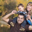 Happy Mixed Race Ethnic Family Posing for A Portrait — Stock Photo