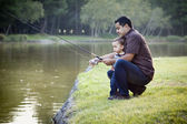 Happy Young Ethnic Father and Son Fishing — Stock Photo