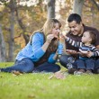 Happy Mixed Race Ethnic Family Playing with Bubbles In The Park — Stock Photo