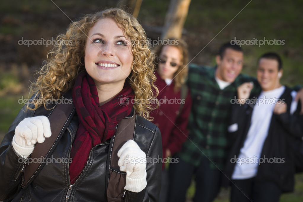 Pretty Young Teen Girl with Three Boys Behind Admiring Her. — Stock Photo #7802412