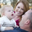 Cute Child Looks Up to Sky as Young Parents Smile — Stock Photo