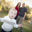 Cute Young Boy Walking as Parents Look On From Behind — Stock Photo #7926147