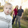 Cute Young Boy Walking as Parents Look On From Behind — Stock Photo #7926158
