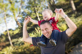 Young Laughing Father and Child Piggy Back — Stock Photo