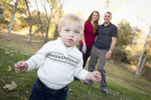 Cute Young Boy Walking as Parents Look On From Behind — Stock Photo