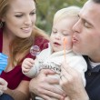 Young Parents Blowing Bubbles with their Child Boy in Park — Stock Photo
