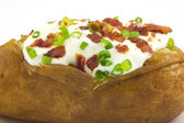 Baked potato with toppings — Stock Photo
