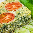 Spinach and feta cheese quiche - Stock Photo