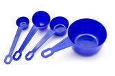 Blue measuring spoons — Stock Photo