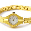 Woman golden wrist watch - Stock Photo