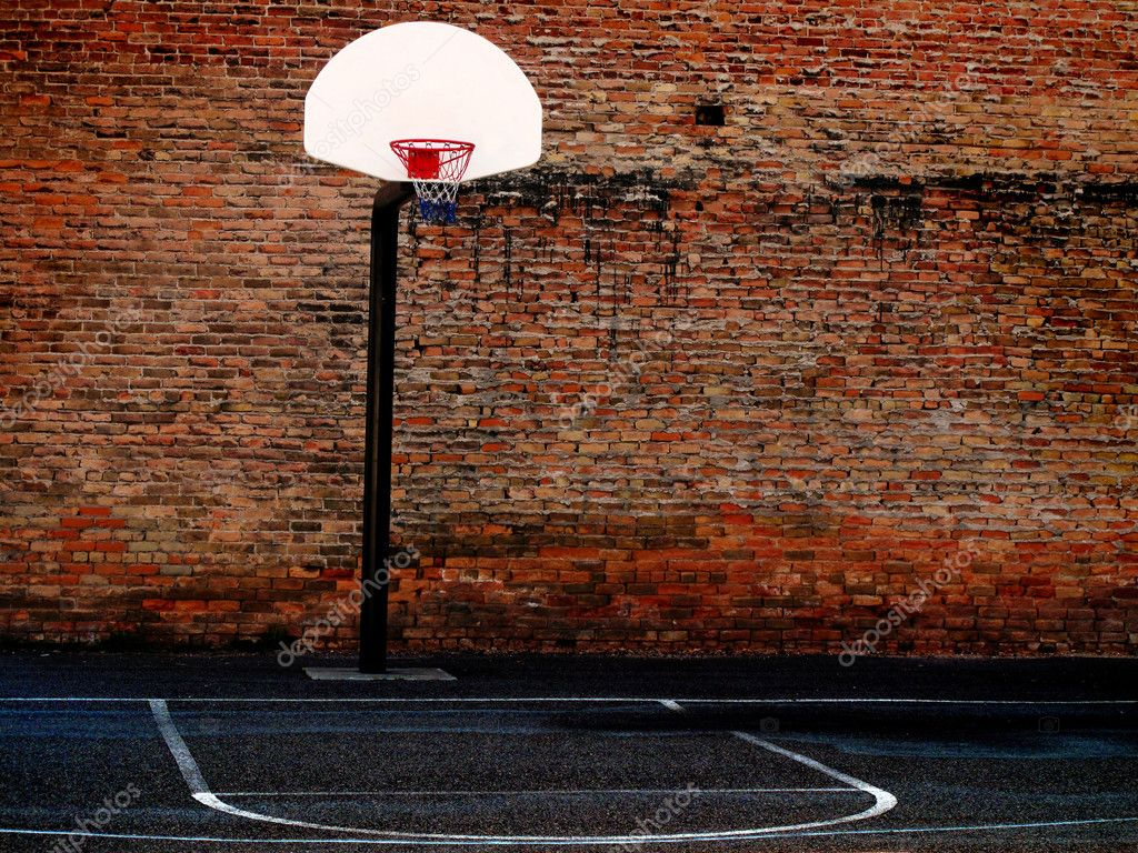 Urban basketball court in neighborhood with old buildings  Stock Photo #7619577