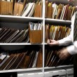 Business man and files on shelf - Stok fotoraf