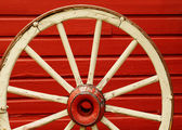Wagon Wheel by Red Wall — Stock Photo