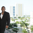 Young black businessman by the ledge — Stock Photo