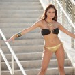 Stock Photo: Bikini model posing in staircase