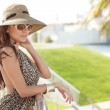 Fashionable woman leaning on a rail — Stock Photo