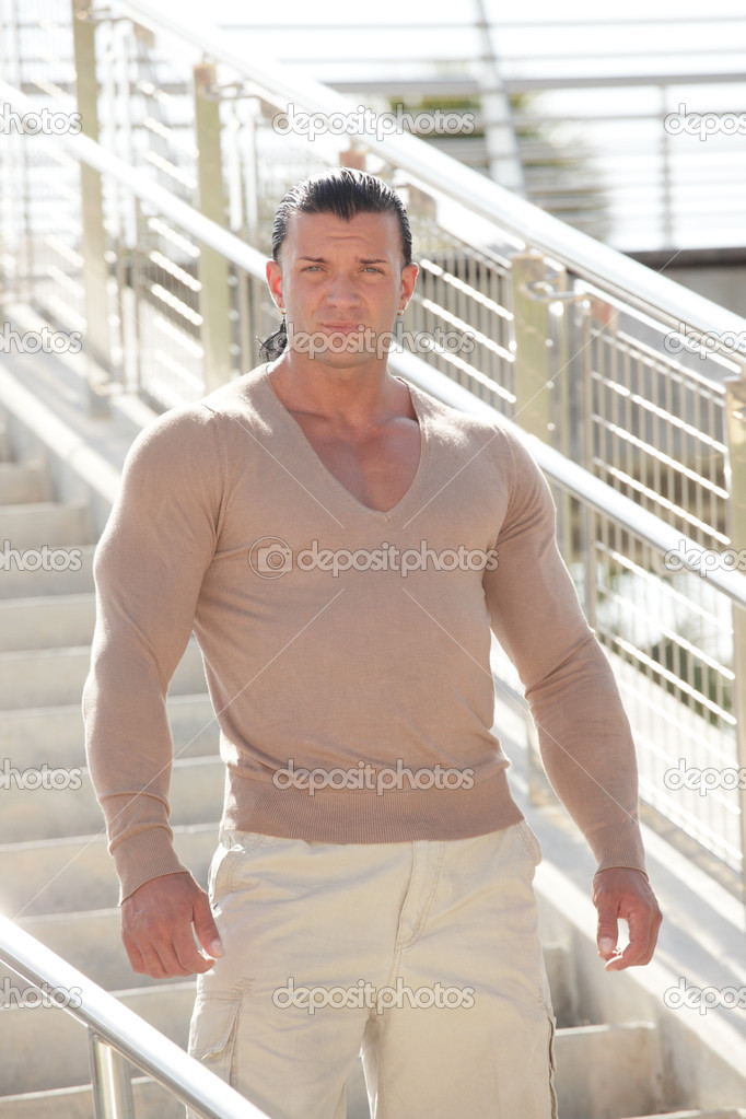 Image of a handsome man posing on a staircase — Stock Photo #7006081