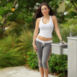 Fit woman by a water fountain — Stock Photo #7140635