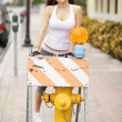 Woman posing by a fire hydrant — Stock Photo #7140655