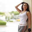 Fitness model leaning on a wall — Stock Photo