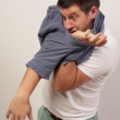 Man tangled in his shirt — Stock Photo #7253597