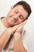 Man pretending to sleep — Stock Photo