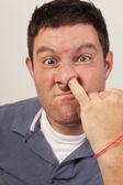 Man picking his nose — Stock Photo