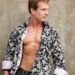 Fashionable mwith shirt unbuttoned — Stock Photo #7396868