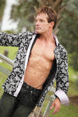 Image of a man with shirt unbuttoned — Stock Photo