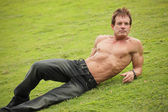 Shirtless man on the grass — Stock Photo