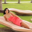 Sexy woman relaxing in the park — Stock Photo #7456523