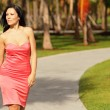 Royalty-Free Stock Photo: Woman in a dress walking in the park